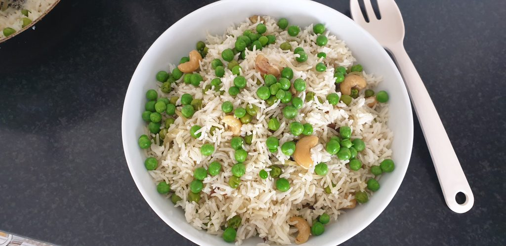 Basmati rice with peas and cashews in a bowl