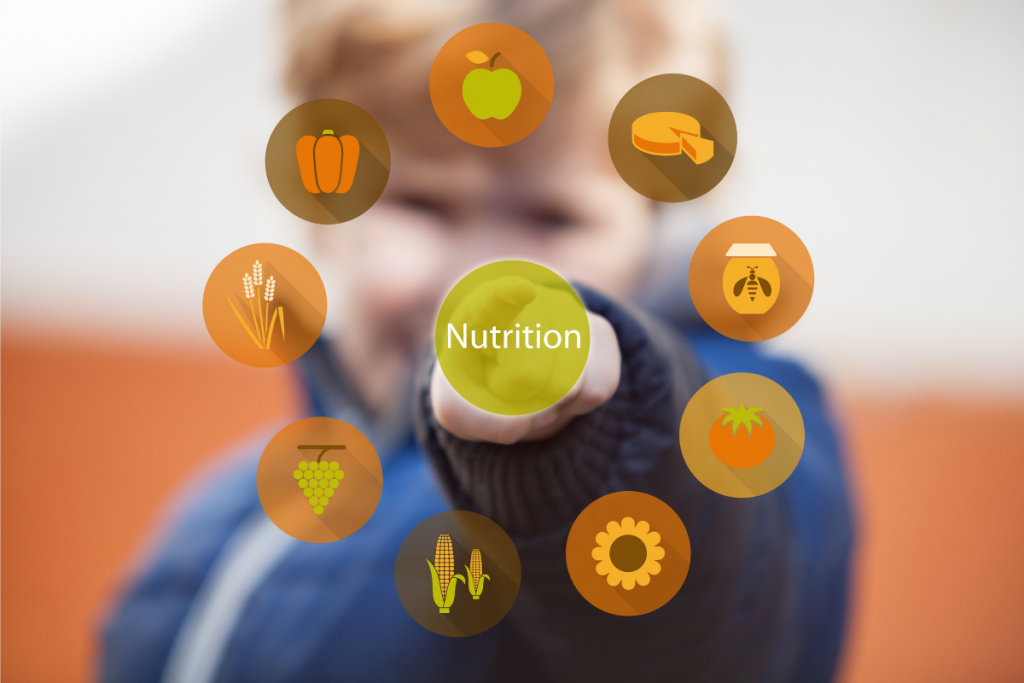 Child pressing the nutrition icon on a touch screen. healthy lifestyle concepts