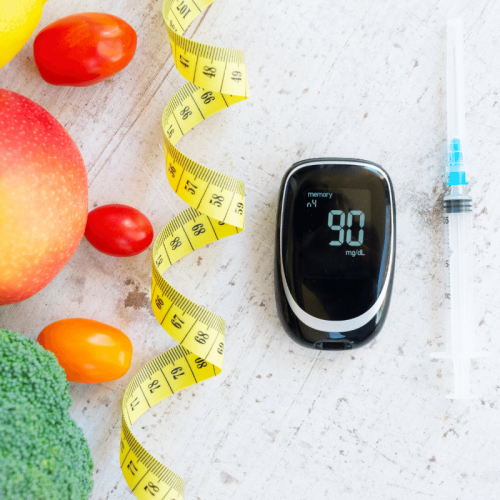 raw vegetables and fruits with blood glucose meter and insulin syringe, healthy diabetes diet.a