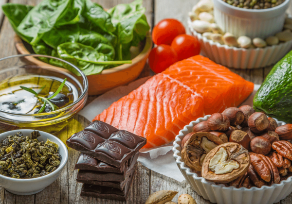 Healthy food, salmon, dark chocolate, spinach, nuts, pepper, olive oil