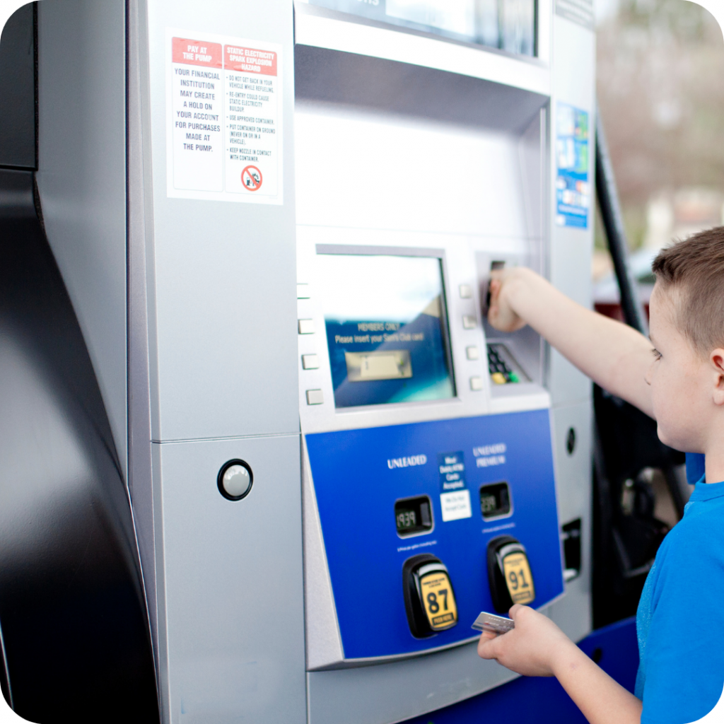 kid at atm, kid paying for gas, boy paying for gas