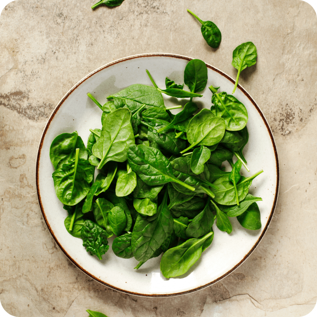 spinach leaves in a white bowl